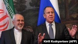 RUSSIA -- Russian Foreign Minister Sergei Lavrov (R) gestures next to his Iranian counterpart Mohammad Javad Zarif during a family photo ahead of a meeting of foreign ministers of the Caspian Sea littoral states in Moscow, December 05, 2017
