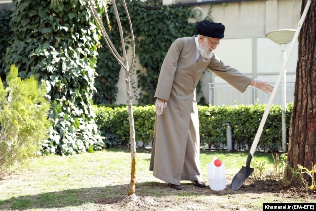 IRAN -- Iranian Supreme Leader Ayatollah Ali Khamenei uses protective gloves as he attends a tree planting ceremony in Tehran, March 3, 2020