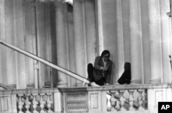 Sim Harris, the BBC sound man, left, leaps to safety from the Iranian Embassy in London on May 5, 1980, as the siege is brought to a close by the action of the police and units of the Special Air Service.