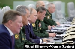 RUSSIA -- Russian President Vladimir Putin (Third Left) visits the National Defence Control Centre (NDCC) to oversee the test of a new Russian hypersonic missile system called Avangard, which can carry nuclear and conventional warheads, in Moscow, Russia.