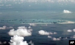 China conducts land reclamation of Mischief Reef in the Spratly Islands of the South China Sea, on May 11, 2015.
