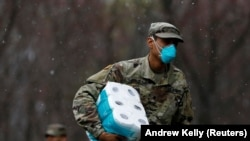 A member of Joint Task Force 2, composed of soldiers and airmen from the New York Army and Air National Guard arrives to sanitize and disinfect the Young Israel of New Rochelle synagogue.