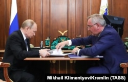 Russian President Vladimir Putin (L) meets with the Head of Russian state space agency Roskosmos Dmitry Rogozin at the Kremlin in Moscow, August 1, 2019.