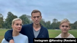 GERMANY -- Russian opposition politician Aleksey Navalny, his wife Yulia and son Zakhar pose for a picture in Berlin, in this undated image obtained from social media October 6, 2020