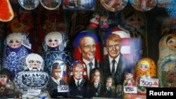 Russia -- Russian traditional Matryoshka wooden dolls with images of Russian President Vladimir Putin, U.S. President Donald Trump and his predecessors are on sale at a gift kiosk in a street in Moscow, February 22, 2017