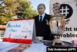 "GERMANY -- A mock offer of ""Novichok Tea"" is seen in front of an effigy of Russian President Vladimir Putin outside the Russian embassy in Berlin, September 23, 2020."