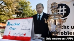"GERMANY -- A mock offer of ""Novichok Tea"" is seen in front of an effigy of Russian President Vladimir Putin outside the Russian embassy on Unter den Linden in Berlin, Sept. 23, 2020."