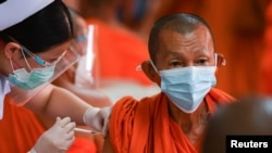 A Buddhist monk receives a dose of the AstraZeneca COVID-19 vaccine at a temple as the in Bangkok on July 30, 2021. Chalinee Thirasupa/Reuters