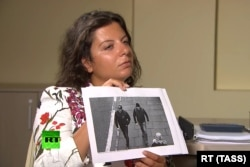 RUSSIA -- RT Editor-in-Chief Margarita Simonyan shows an image of two men during an interview with Aleksandr Petrov and Ruslan Boshirov, who are suspected by the British authorities of poisoning former GRU officer Sergei Skripal and his daughter Yulia.