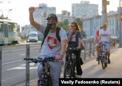 Minsk, Belarus - Participants ride bicycles during a protest flash mob.
