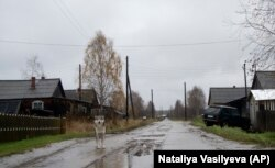 RUSSIA -- A dog walks on the street in the village of Loyga, northern Russia, October 10, 2018