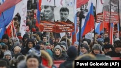 Ksenia Sobchak, centre bottom, attends a rally in memory of opposition leader Boris Nemtsov, Moscow, February 25, 2018.