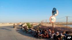 Afghan military personnel crossed the Tajikistan border from Afghanistan's Badakhshan province as Taliban fighters advanced toward the border, June 22, 2021. (Source: Republic of Tajikistan)