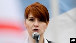 RUSSIA -- Maria Butina, leader of a pro-gun organization in Russia, speaks to a crowd during a rally in support of legalizing the possession of handguns in Moscow, April 21, 2013