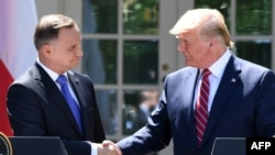 U.S. -- US President Donald Trump and Polish President Andrzej Duda shake hands after holding a joint press conference in the Rose Garden of the White House in Washington, DC, June 12, 2019.