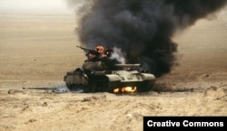 Burning Iraqi tank during Desert Storm operation, February 1991