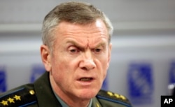 Russia's Deputy Chief of General Staff Anatoly Nogovitsyn addresses the media in Moscow, August 13, 2008. Nogovitsyn said August 15 that Poland's agreement to accept a U.S. missile defense battery exposes it to attack, adding that Russia can use nuclear weapons if it has to.