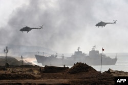 "Russia's navy ships and helicopters take part in a military exercise ""Kavkaz"" 2016 at the coast of the Black Sea in Crimea on September 9, 2016."