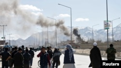 Afghanistan -- Smoke rises from the site of a blast and gunfire between Taliban and Afghan forces in PD 6 in Kabul, March 1, 2017