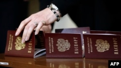 Ukraine -- Passports of the Russian Federation lie on a table as Crimean residents receive them in Simferopol, on April 15, 2014