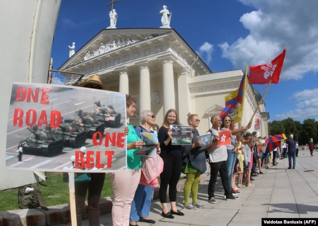 "LITHUANIA -- People take part in a human chain protest in support of the Hong Kong Way, a recreation of a pro-democracy ""Baltic Way"" protest against Soviet rule three decades ago, in Vilnius, August 23, 2019"