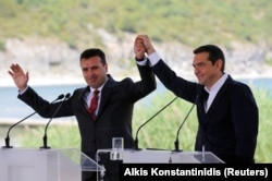 Greek Prime Minister Alexis Tsipras and Macedonian Prime Minister Zoran Zaev gesture before the signing of an accord to settle a long dispute over the former Yugoslav republic's name in the village of Psarades, in Prespes, Greece, June 17, 2018. REUTERS/A