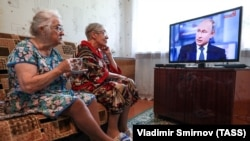 RUSSIA -- Elderly women watch a live broadcast of Russian President Vladimir Putin's annual question and answer session in the village of Yelna, Ivanovo region, June 7, 2018.