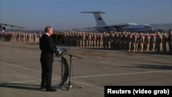 Russian President Vladimir Putin speaks to Russian forces on surprise visit to Russia's Hmeymim air base in Syria's Latakia Province on December 11, 2017.