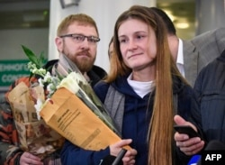 RUSSIA -- Maria Butina, who served nine months in a U.S. jail for acting as a Russian government agent arrives at Moscow's Sheremetyevo airport on October 26, 2019, a day after her release from prison.