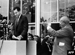 USSR -- US vice president Richard Nixon (L) being applauded by Soviet leader Nikita Khrushchev (R) after he delivered a speech during a visit at the American National Exhibition on July 27, 1959
