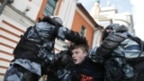RUSSIA – Law enforcement officers detain a man after a rally demanding authorities allow opposition candidates to run in the upcoming municipal election in Moscow, Russia August 10, 2019.
