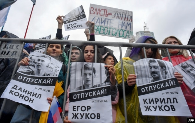"Russia -- Protesters hold a poster reading ""Free [jailed student] Kirill Zhukov!"" during a rally in central Moscow on 10Aug2019"