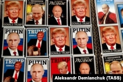 FINLAND -- Magnets depicting Russian President Vladimir Putin and U.S. President Donald Trump are displayed on sale at the Ruslania bookshop in Helsinki, October 2, 2018