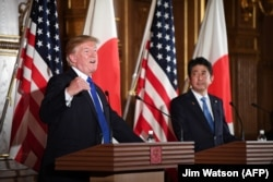 U.S. President Donald Trump and Japanese Prime Minister Shinzo Abe attend a joint press conference at Akasaka Palace in Tokyo, November 6, 2017.