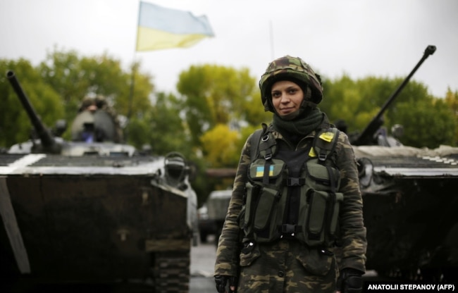 UKRAINE – A Ukrainian female soldier poses at a camp near the village of Luhanske in the Donetsk region, September 24, 2014