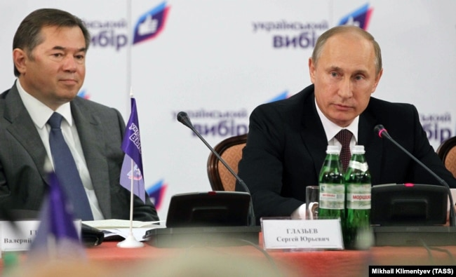UKRAINE – Russia's president Vladimir Putin (R) and his adviser Sergei Glazyev at a conference titled 'Orthodox and Slavic identity as the basis of choice of civilisation in Ukraine'. Kyiv, July 27, 2013