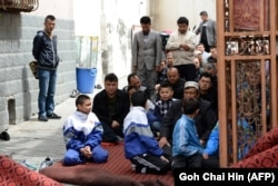 China -- Children join the adults at a mosque for Friday prayers in Urumqi, the capital of farwest China's Muslim Uighur homeland of Xinjiang, May 23, 2014