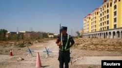 CHINA – A Chinese police officer takes his position by the road near what is officially called a vocational education centre in Yining in Xinjiang Uighur Autonomous Region, China, on Sept. 4, 2018.