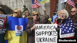 Demonstration in support of Ukraine outside the UN during a meeting of the UN General Assembly on the question of integrity of Ukraine, New York, Mar 27, 2014. A General Assembly resolution recognized Crimea's annexation by Russia as illegal.