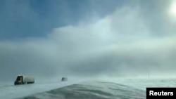 Trucks drive amidst heavy snow near Fargo, North Dakota, U.S., January 29, 2019, in still image taken from a video taken from social media. Carol Bauer/via REUTERS