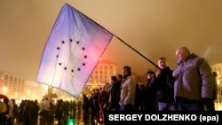 Ukraine -- A man holds a EU flag during a protest at Independence square in downtown Kyiv, November 22, 2013