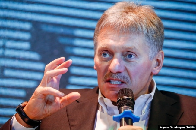RUSSIA -- Kremlin spokesman Dmitry Peskov gestures as he speaks during an interview at the MediaDen Forum marking 5 years of Kommersant Journalism Academy, in Moscow, February 6, 2019
