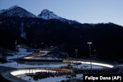 RUSSIA -- The Sanki Sliding Center is lit up for the start of the men's skeleton final competition at the 2014 Winter Olympics, Saturday, Feb. 15, 2014, in Krasnaya Polyana, Russia.