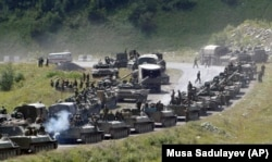 GEORGIA -- A column of Russian armored vehicles seen on their way to the South Ossetian capital Tskhinvali somewhere in the Georgian breakaway region, South Ossetia, August 9, 2008.