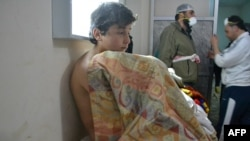 Syria -- A young man sits on a bed at a clinic in the village of Sarmin, southeast of Idlib, March 17, 2015