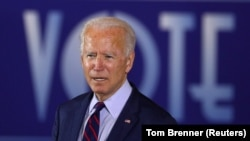 U.S. Democratic presidential candidate Joe Biden delivers remarks at a Voter Mobilization Event campaign stop at the Cincinnati Museum Center at Union Terminal in Cincinnati, Ohio, U.S., October 12, 2020.