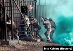 Latvian Army soldiers practice urban fighting during Silver Arrow 2017 multinational military drills involving eleven NATO members in Adazi, Latvia, October 29, 2017.