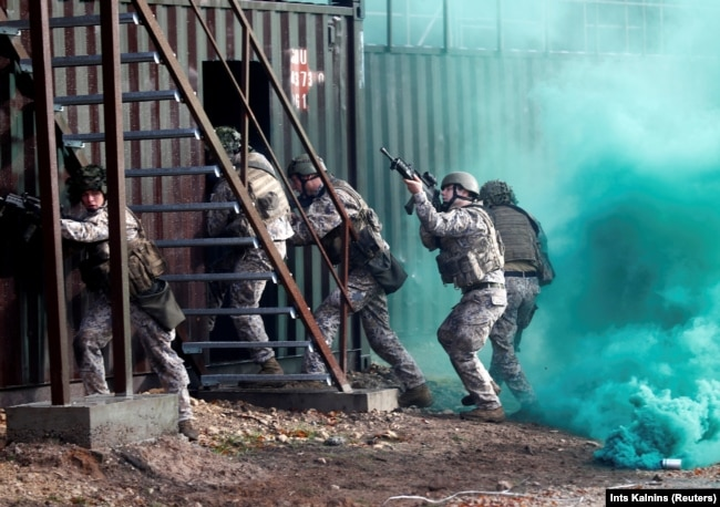 Latvian Army soldiers practice urban fighting during Silver Arrow 2017 multinational military drills involving eleven NATO members in Adazi, Latvia October 29, 2017.