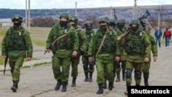 Ukraine – Russian military forces invaded Crimea peninsula. Russian soldiers (faces) in Perevalne, Crimea, March 5, 2014