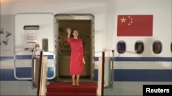 Huawei Technologies Chief Financial Officer Meng Wanzhou waves upon arriving from Canada at Shenzhen Baoan International Airport, in Shenzhen on September 25, 2021. (CCTV via Reuters)